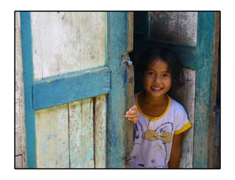 32 - Girl-in-Takengon-on-a-door---Indonesia